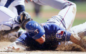 Josh Hamilton lands on the DL for 4-6 weeks with a fractured right arm after this hard slide yesterday against the Tigers. (Getty Images/Gregory Shamus)