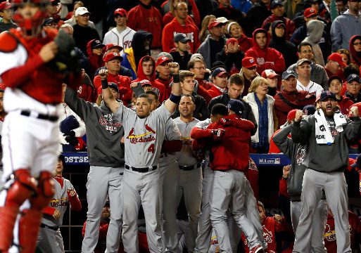 The Cardinals' bench erupts, while Nationals fans are stunned as the ninth inning unfolds. (Getty Images)