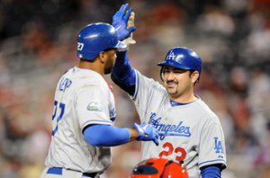 Matt Kemp high fives Adrian Gonzalez at home plate.
