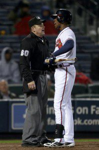 Atlanta Braves batter B.J. Upton talks to an umpire after striking out.