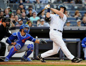 Travis Hafner swings and gets a hit for the New York Yankees.