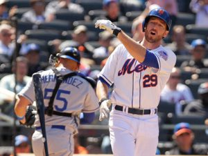 Ike Davis throws his bat after striking out.