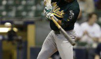 Coco Crisp swings and connects against the Brewers.
