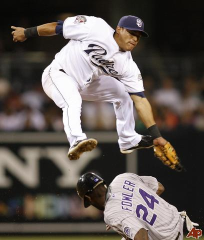 Everth Cabrera leaps and turns a double play.