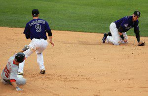 Troy Tulowitzki is down on all fours after stopping a ground ball.
