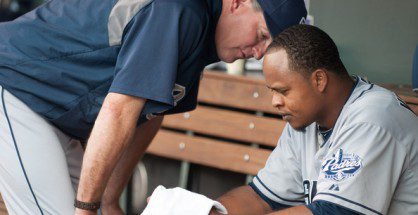 Edinson Volquez gets a talk from manager Bud Black in the dugout.