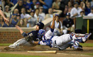 Cubs catcher Welington Castillo tags out Jonathan Lucroy at home plate. (JSOnline.com)