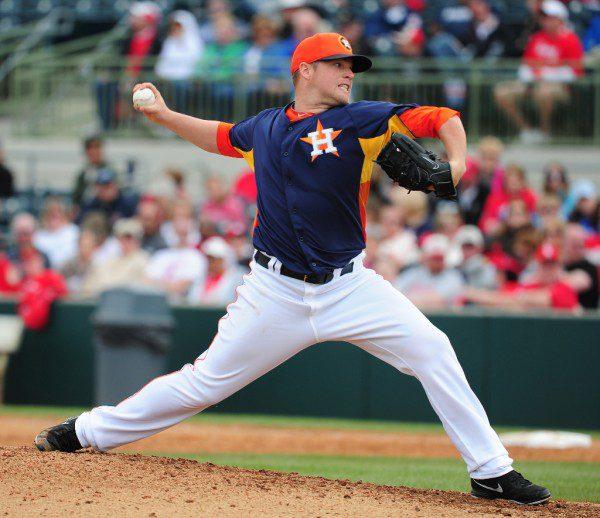 Houston Astros pitcher Bud Norris strides toward home.