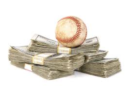 Baseball betting: a stack of money with a baseball on top