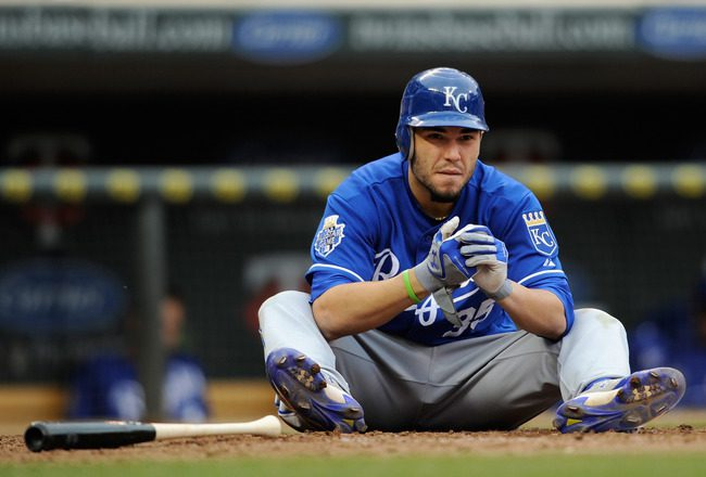 Eric Hosmer sits on the ground after making an out.