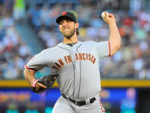 Madison Bumgarner throws a pitch.