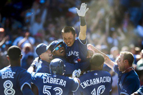 Toronto Blue Jays celebrate at home after a walk-off win.