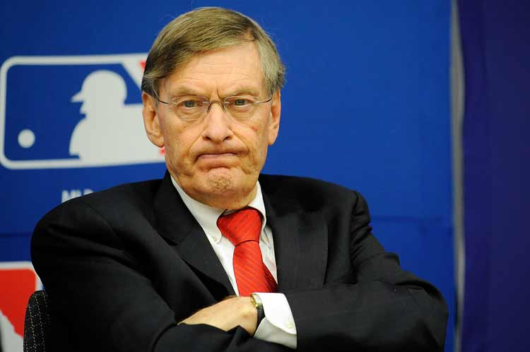 Bud Selig staring with arms crossed.