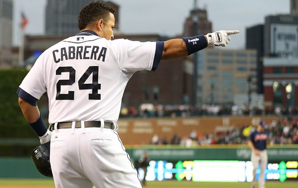 Miguel Cabrera standing on the field and pointing toward first.