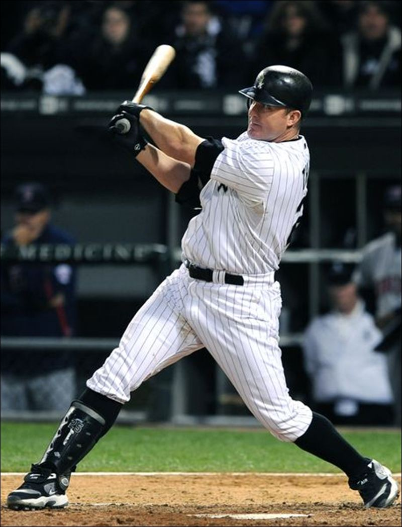 Jim Thome swings and connects.