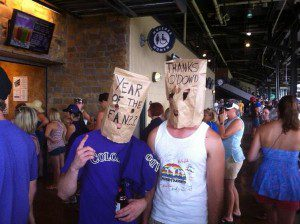 Rockies fans wearing paper bags over their heads.